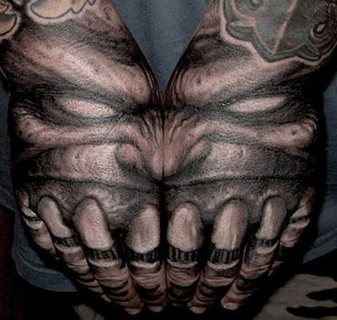 Massive very detailed alien like black and white monster face tattoo on arms