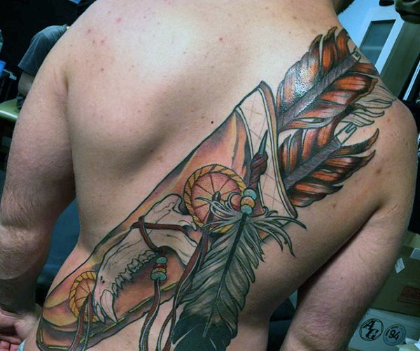 Massive very detailed colorful Indian quiver tattoo on back stylized with animals bones and feather