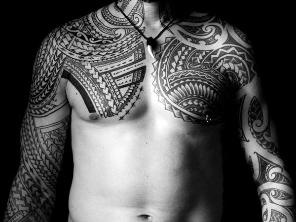 Massive very detailed various tribal ornaments tattoo on sleeve and chest