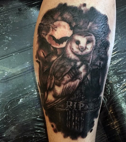 Master like painted black and white leg tattoo of creepy owl on cemetery tattoo with lettering