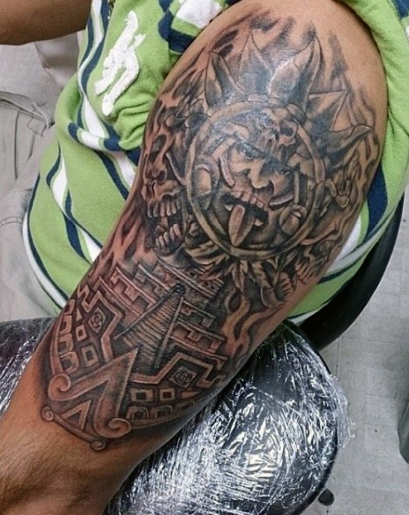 Mayan tribe traditional black ink tablet tattoo on shoulder with small temple