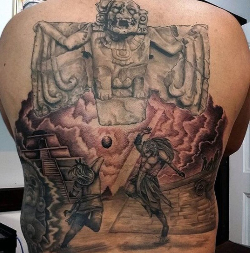 Mayan tribe traditional statue tattoo on whole back combined with warriors fight