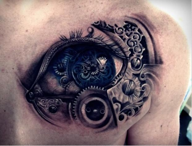Tatuaggio colorato sul petto l&quotocchio grande in stile meccanico
