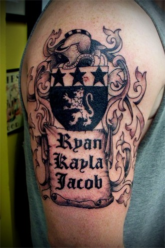Medieval family crest tattoo on shoulder for Family motto tattoos
