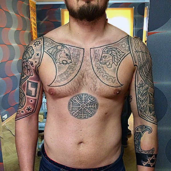 Medieval themed colored chest and arms tattoo of axes and mystical symbols stylized with various animals