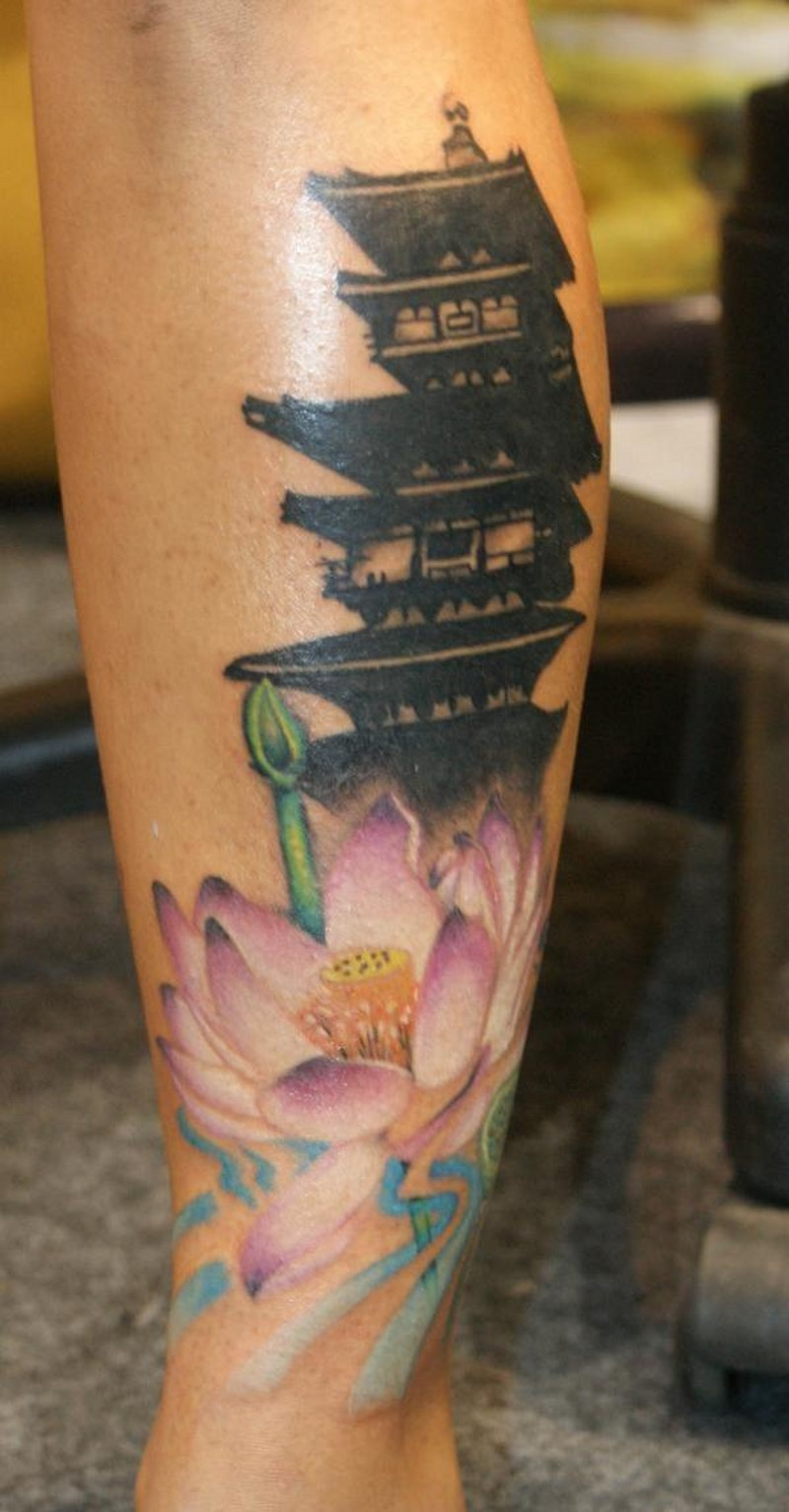 Medium black ink old Asian temple tattoo on leg combined with colored flower