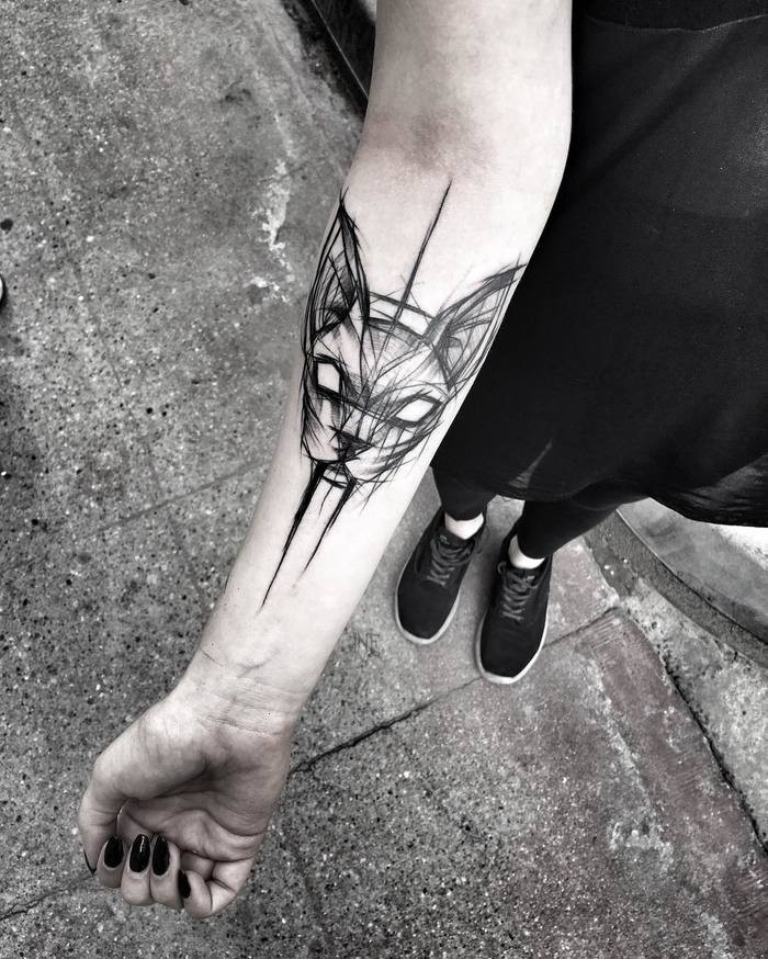 Medium size black ink cat head tattoo sketch painted by Inez Janiak on forearm