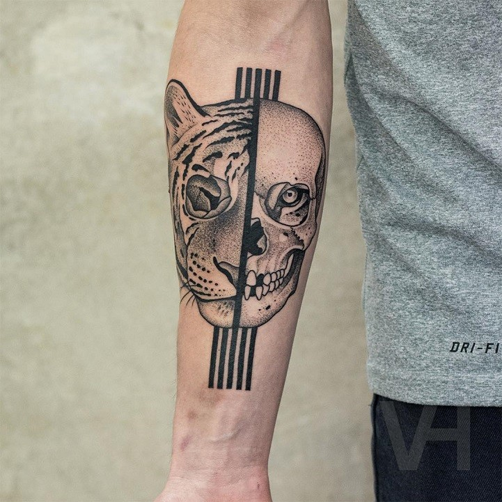 Medium size black ink forearm tattoo designed by Valentin Hirsch of human skull and tiger head