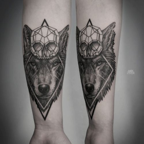 Medium size black ink forearm tattoo of large wolf with diamond skull