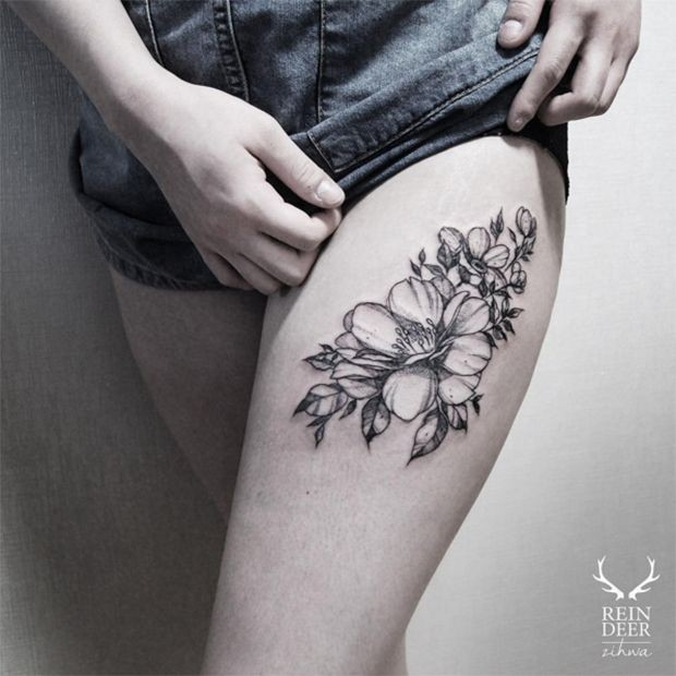 Medium size black ink painted by Zihwa tattoo of flowers on thigh