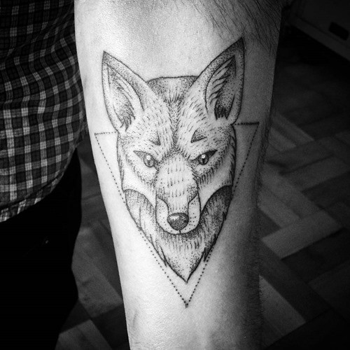 Medium size black ink steady fox tattoo on forearm with triangle