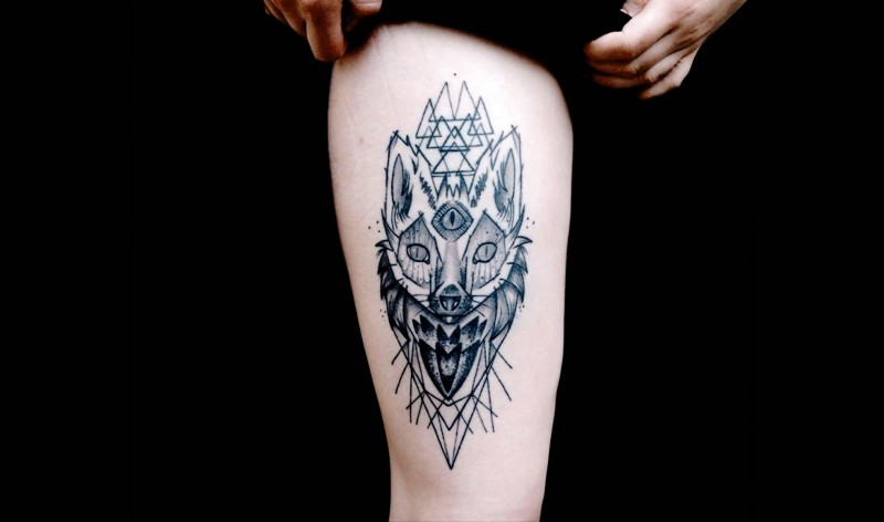 Medium size black ink thigh tattoo of mysterious fox with mask and triangles