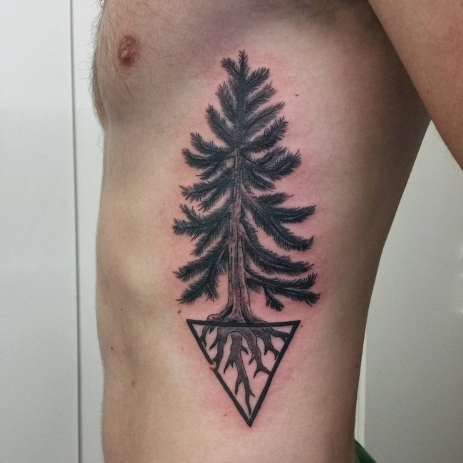 Medium size black ink tree tattoo on side with black triangle