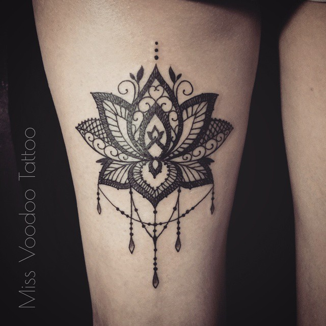 Medium size blackwork style painted by Caro Voodoo thigh tattoo of floral ornament