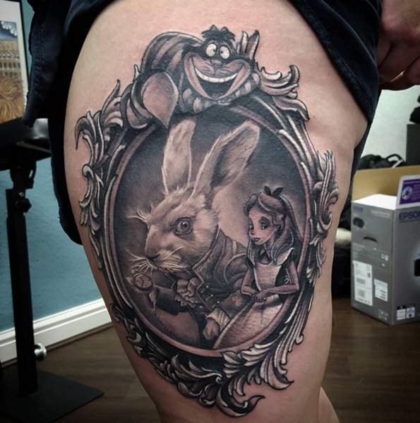 Medium size colored detailed famous cartoon heroes portrait tattoo on thigh area