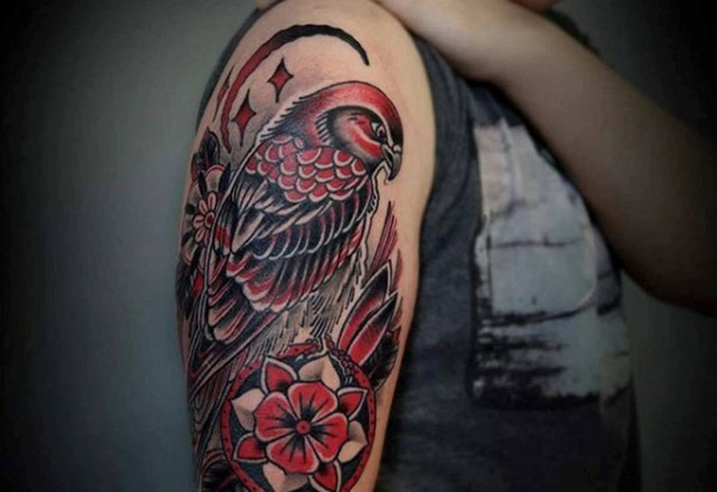 Medium size colored eagle tattoo on shoulder with flowers and moon