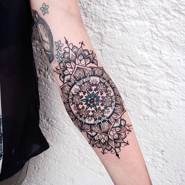 Medium size colored forearm tattoo of beautiful flower