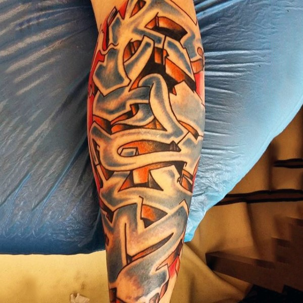 Medium size colored leg tattoo of cool graffiti lettering