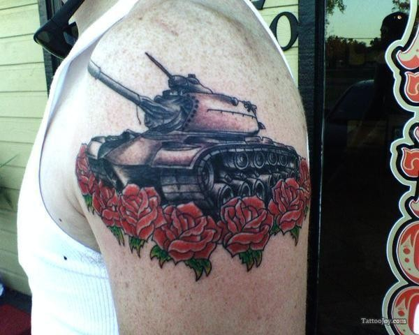 Medium size colored shoulder tattoo of American tank with flowers