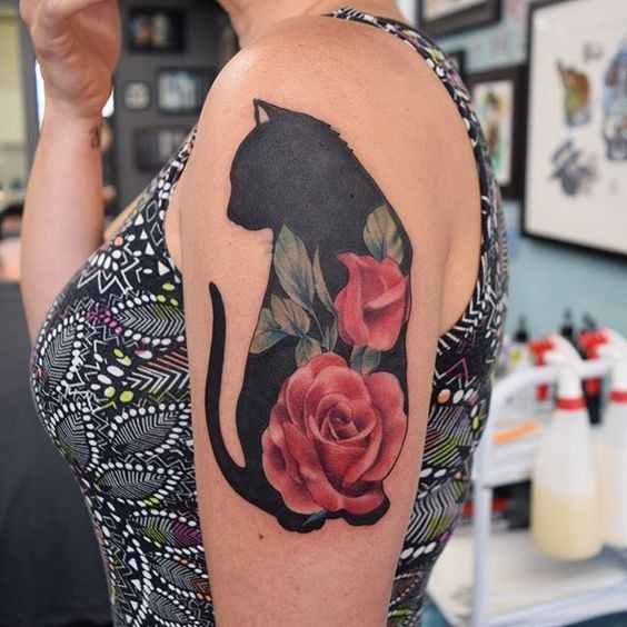 Medium size colored shoulder tattoo of big cat with flowers