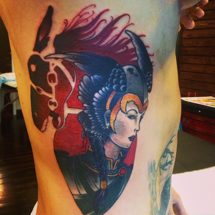 Medium size colored side tattoo of fantasy woman warrior