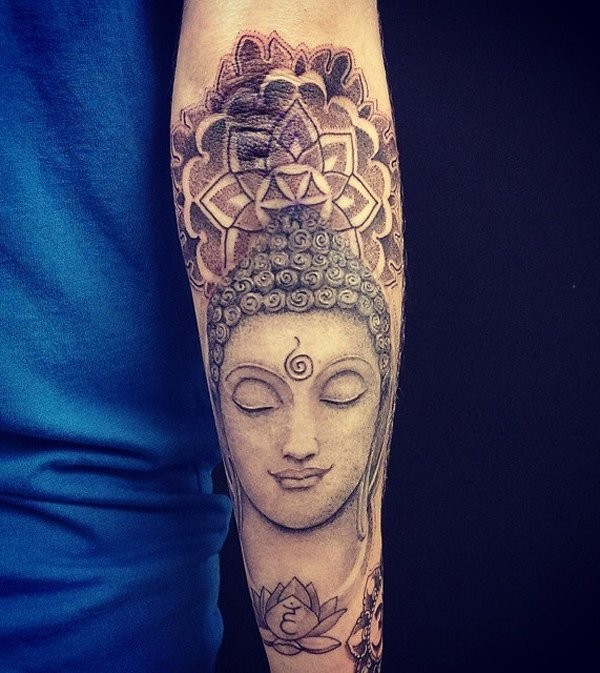 Medium size dot style stone Buddha statue tattoo on forearm combined with ornamental flowers
