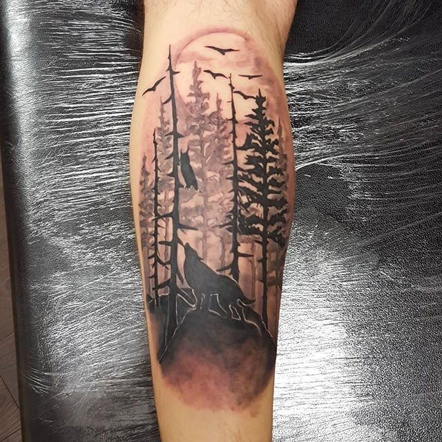 Medium size illustrative style leg tattoo of forest with animals