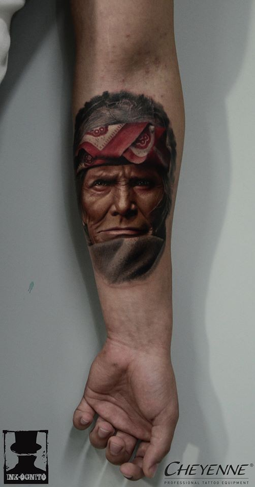 Medium size realism style colored forearm tattoo of old Indian face