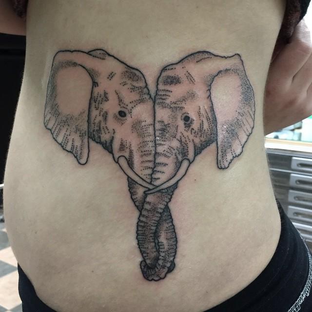Medium size stippling style elephant couple tattoo on side