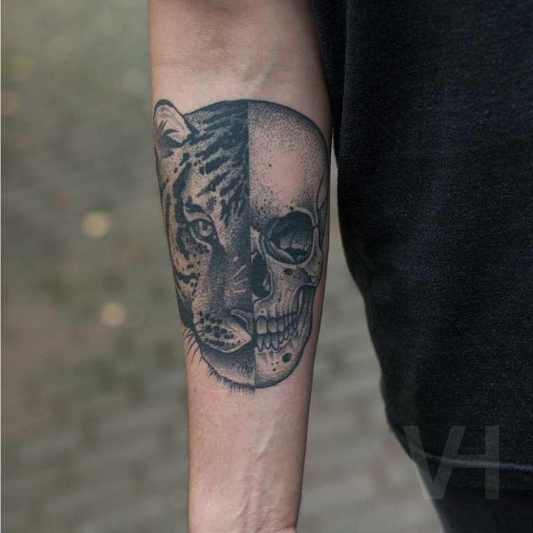 Medium size typical Valentin Hirsch design tattoo of split human skull with tiger head