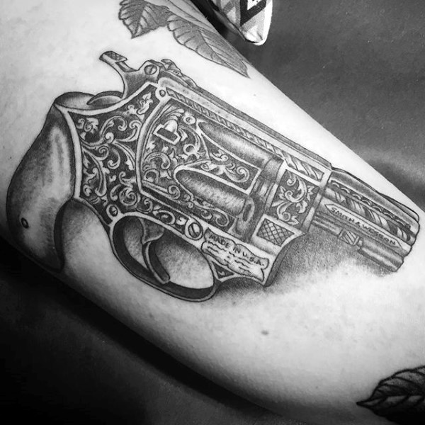 Medium sized black ink 3D style beautiful lady pistol tattoo