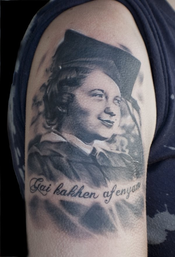 Memorial style black and white collage boy tattoo on shoulder with lettering
