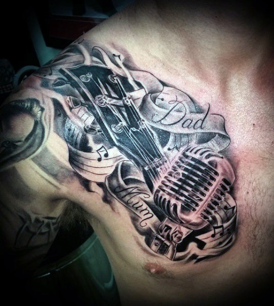 Memorial style desinged black and white musical tattoo on chest with letteirng