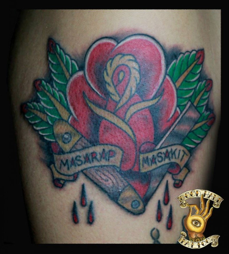 Memorial style simple colored rose with bloody razor blade and lettering tattoo on leg