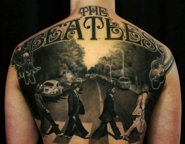 Memorial The Beatles themed back tattoo of music band walking across the road
