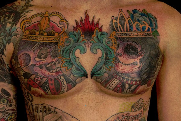 Mexican native colorful skeleton king and queen portraits tattoo on chest