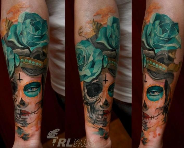 Mexican native designed colored woman portrait tattoo on forearm with blue rose