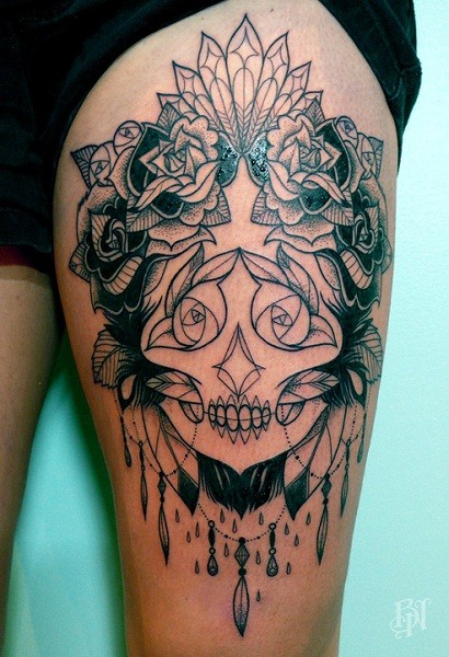 Mexican native detailed black and white on thigh tattoo of portrait shaped flowers