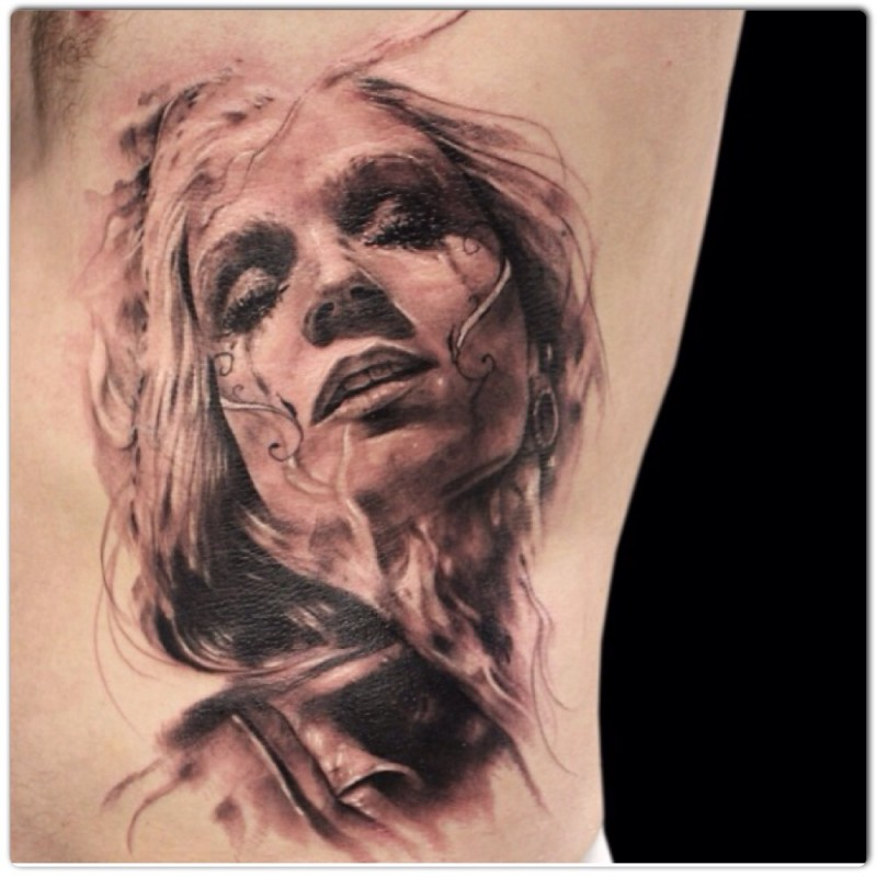 Mexican native detailed side tattoo of woman portrait