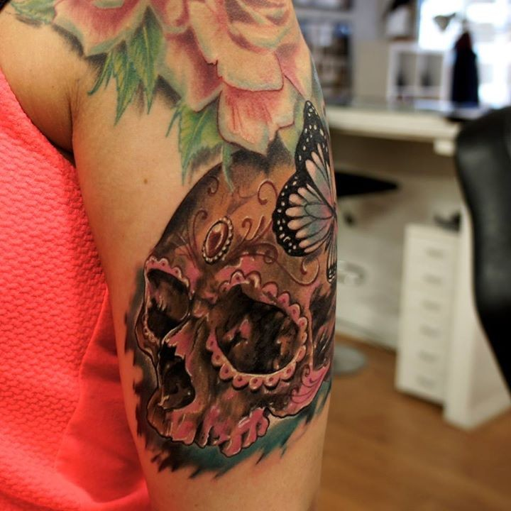 Mexican native shoulder tattoo of human skull with butterfly