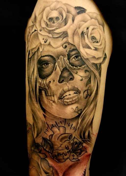 Mexican style black and white shoulder tattoo of woman portrait with roses