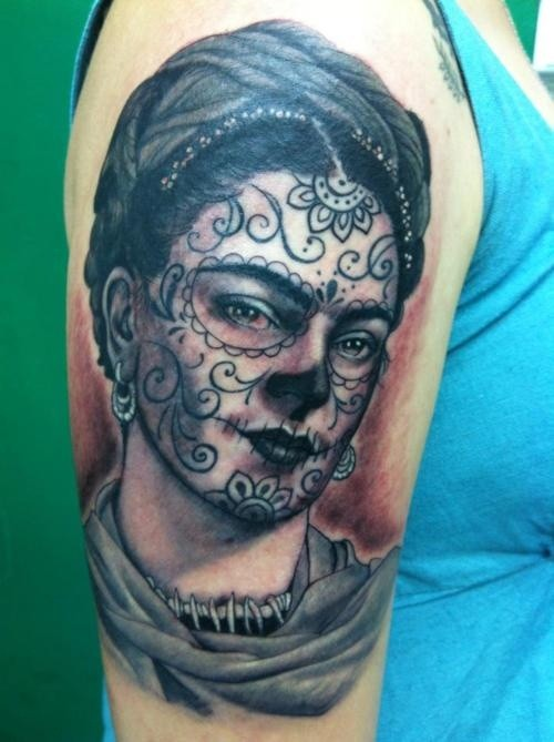 Mexican style black ink thigh tattoo of woman with for Mexican style tattoos