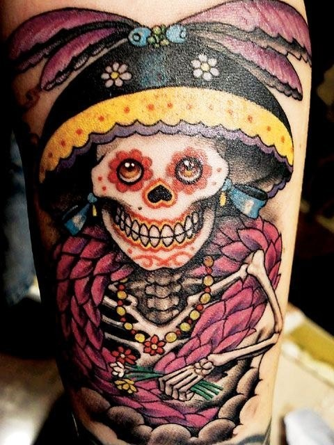 Mexican style cartoon like antic lady skeleton tattoo on thigh with flowers