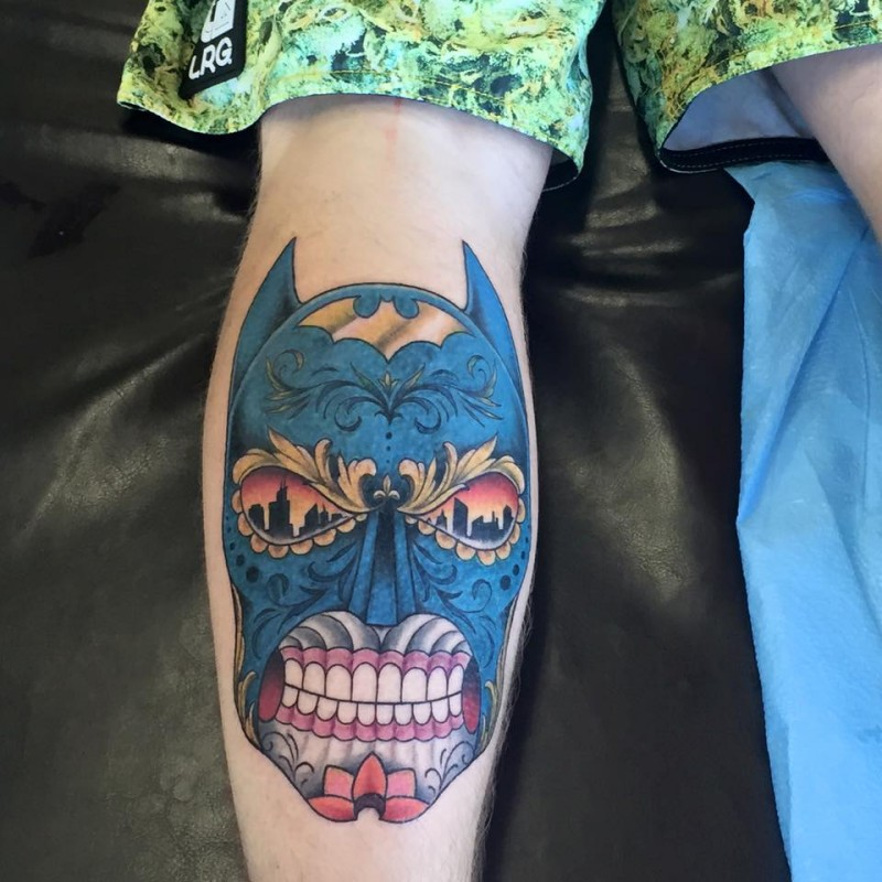 Mexican style colored leg tattoo of Batman face