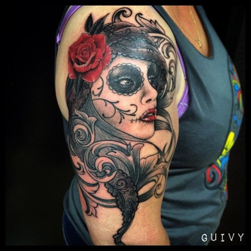 Mexican style colored shoulder tattoo of woman portrait for Mexican style tattoos