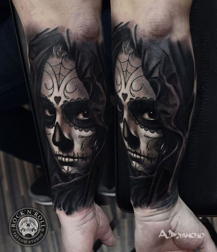Mexican traditional black and white woman portrait tattoo on forearm