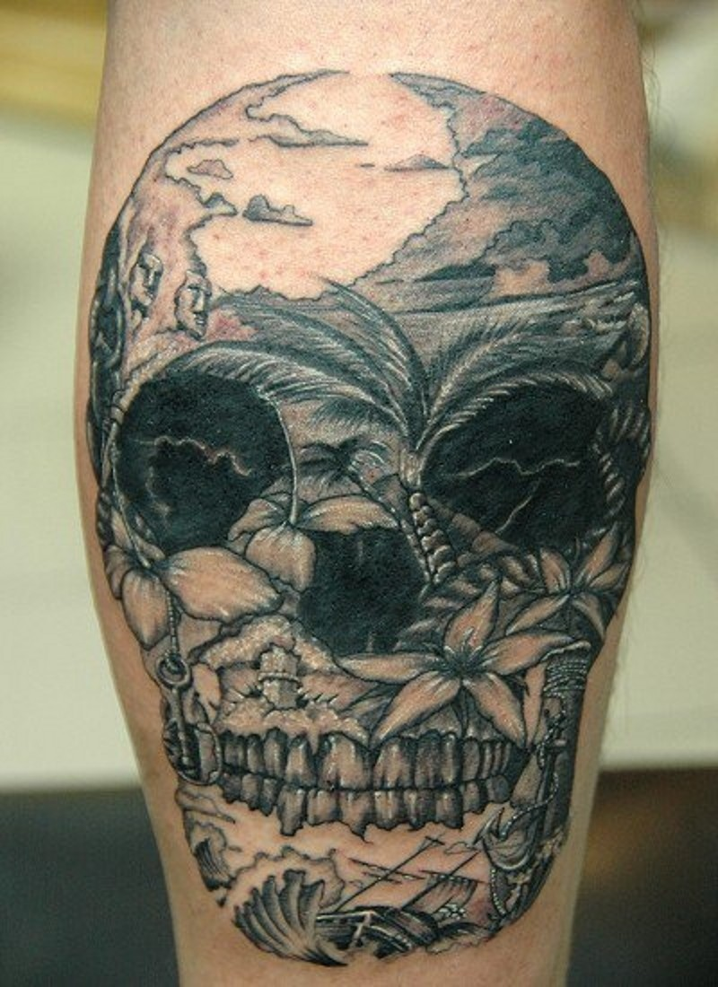 Mexican traditional black ink skull tattoo on leg stylized with wild island shore