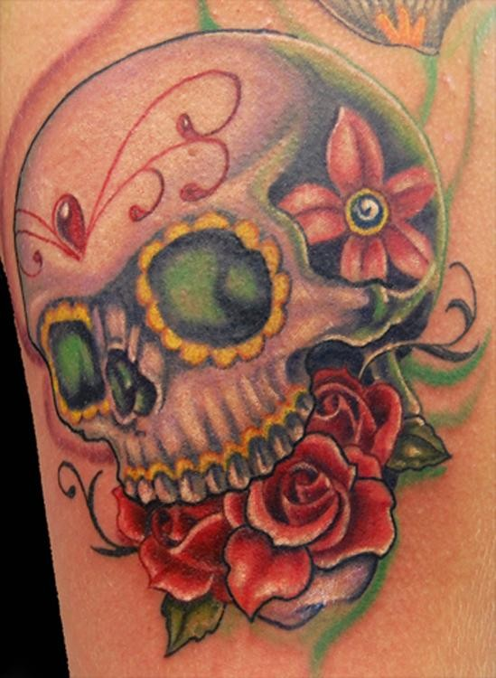 Mexican traditional colored human skull tattoo stylized with red flowers