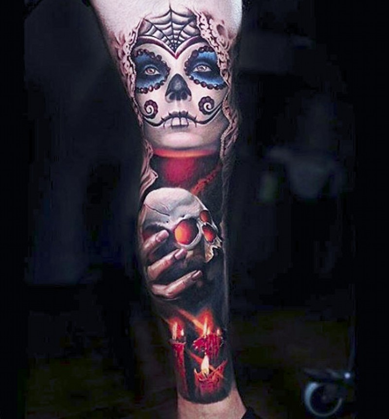 Mexican traditional colored leg tattoo of creepy witch with candle and human skull