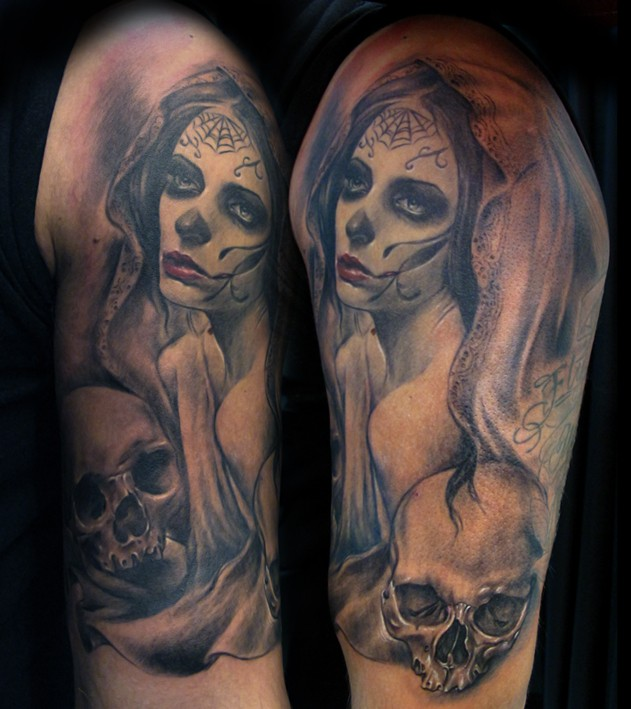 Mexican traditional colored shoulder tattoo of woman portrait and skulls